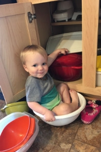toddler sitting in bowl
