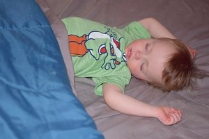 sleeping toddler in his own bed