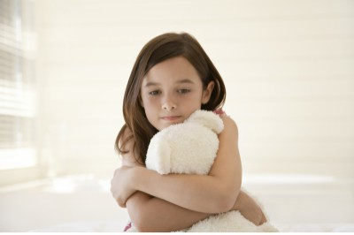 little girl holding bear