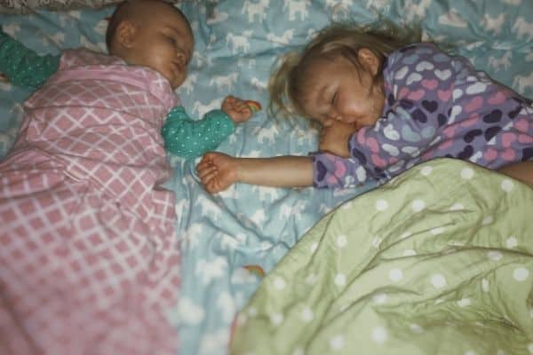 newborn and infant sleeping after tandem nursing